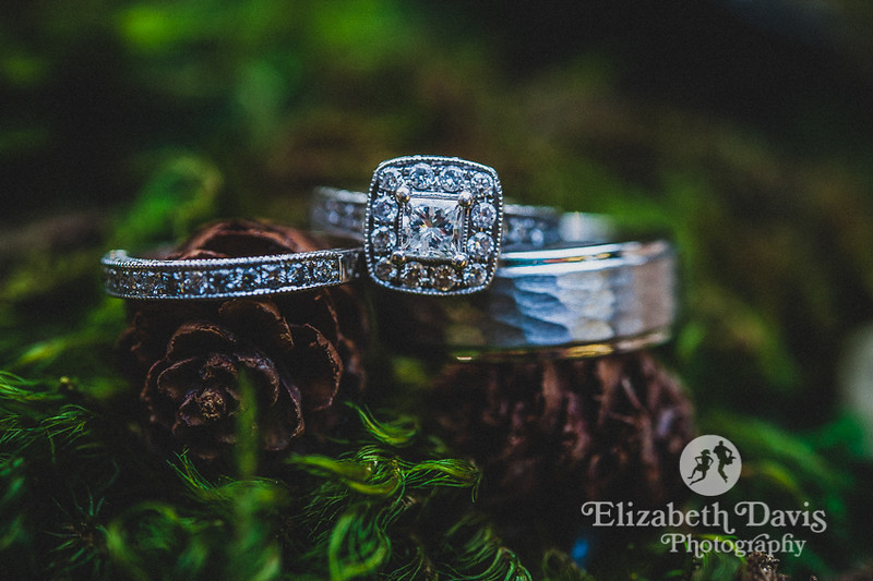 Enchanted Lichgate Wedding | details, gorgeous rings on moss and tiny pinecones | Elizabeth Davis Photography