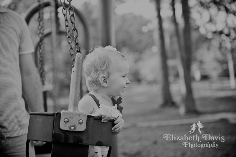 Tallahassee family baby photographer baby swinging on swing