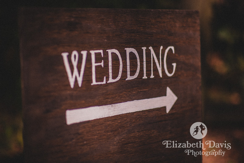 Enchanted outdoor Fall Lichgate Wedding | details, handpainted wooden signs | Elizabeth Davis Photography