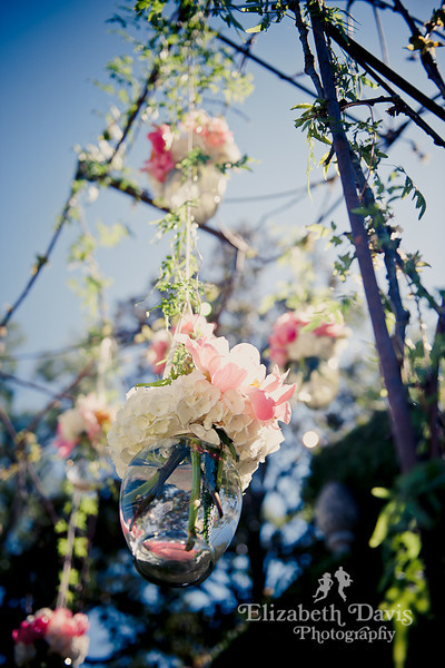 Tallahassee wedding photographer altar with hanging flowers at pebble hill