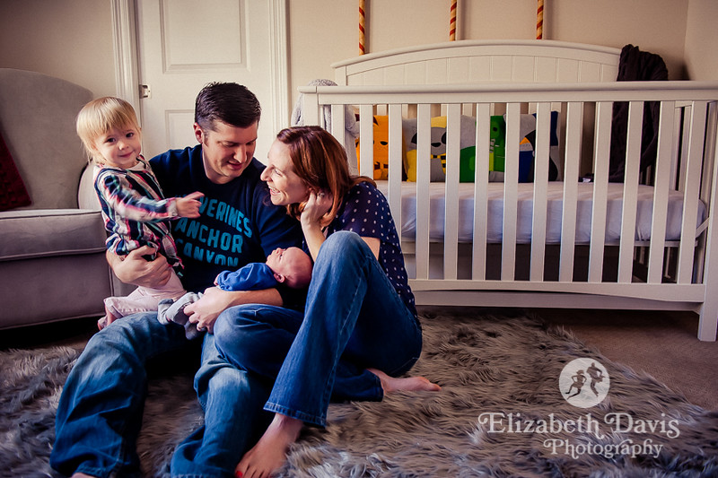 Family of four, toddler and infant plus mom and dad in nursery | Tallahassee family photo session by Elizabeth Davis
