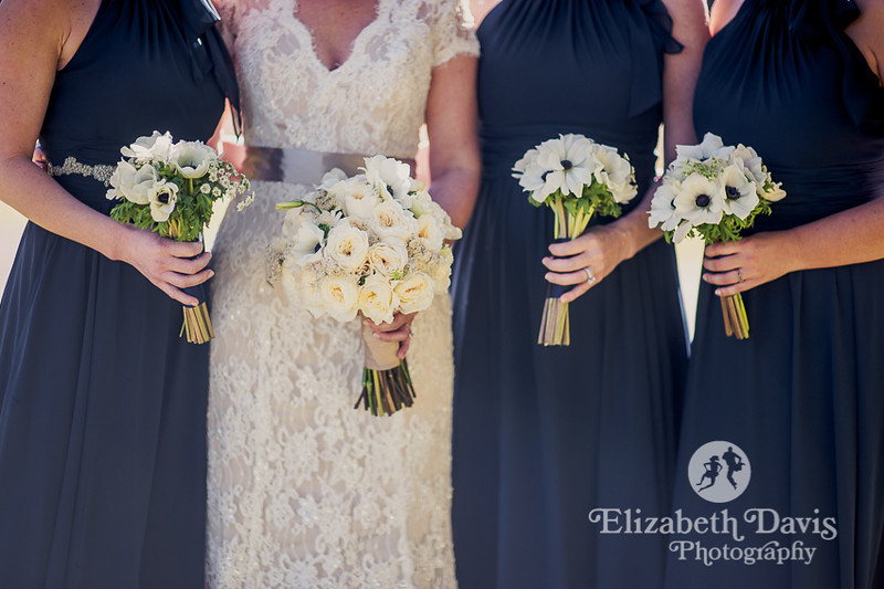 bride and bridesmaids in dark blue gowns with white flowers| Southern outdoor wedding | Elizabeth Davis Photography