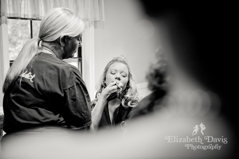 Tallahassee wedding photographer bride getting makeup done