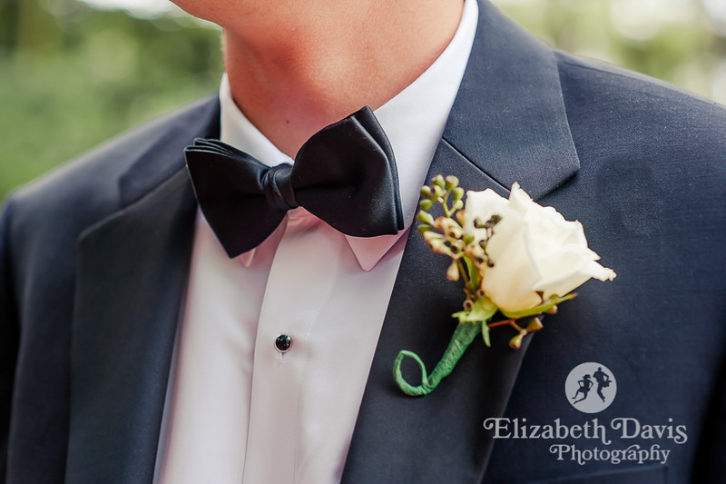 Groomsman in suits with black bowties and white rose boutonnieres   Elizabeth Davis Photography