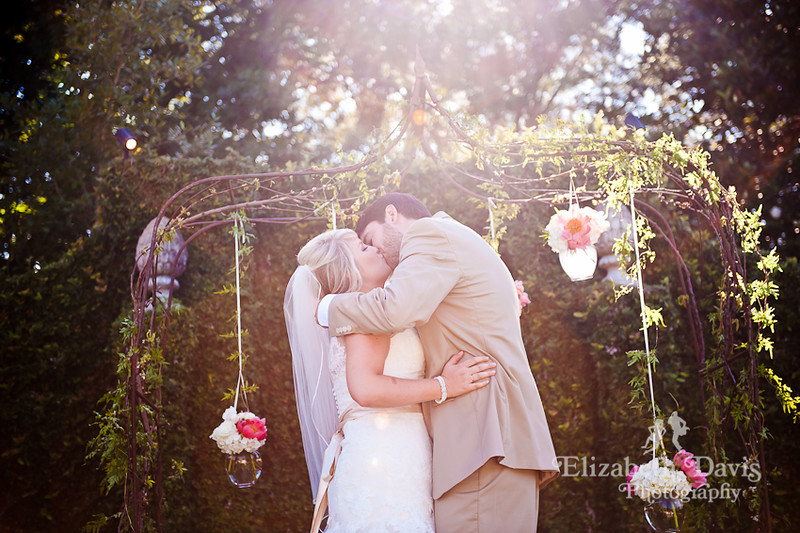 Tallahassee wedding photographer bride and groom first kiss