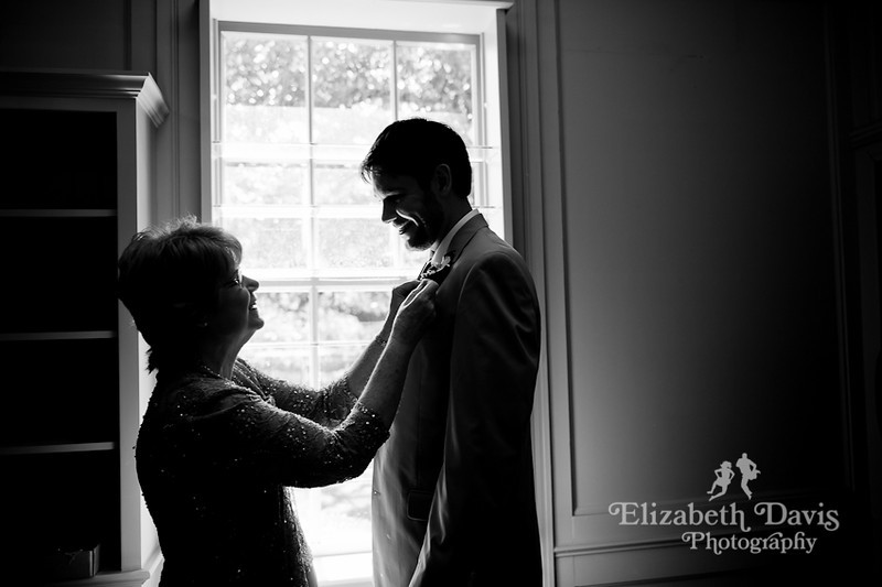 Tallahassee photography mom pinning boutonniere on groom