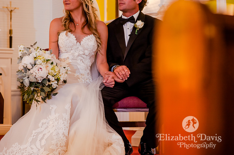 bride and groom seated at ceremony   Elizabeth Davis Photography