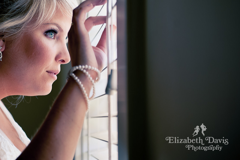 Tallahassee photography bride peaking out window at groom