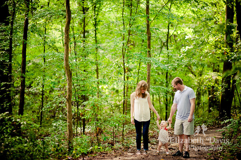 Tallahassee family baby photographer family walking in the woods