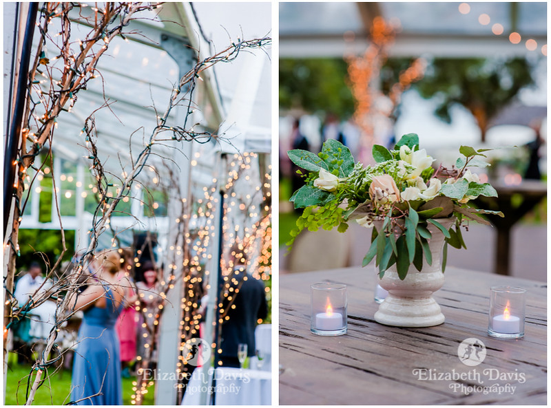 professional lighting at outdoor wedding reception in Alabama and clay vases filled with flowers centerpieces on wood family style dinner tables   Elizabeth Davis Photography