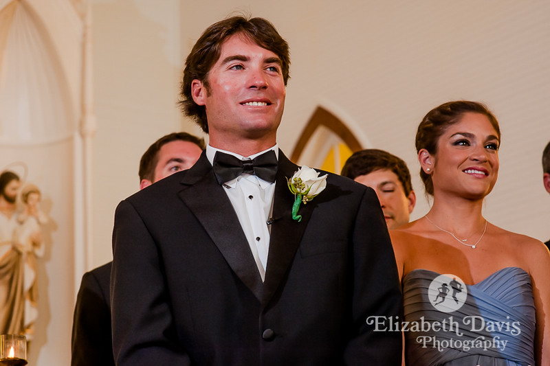 groom seeing bride for the first time walking up aisle by Elizabeth Davis Photography