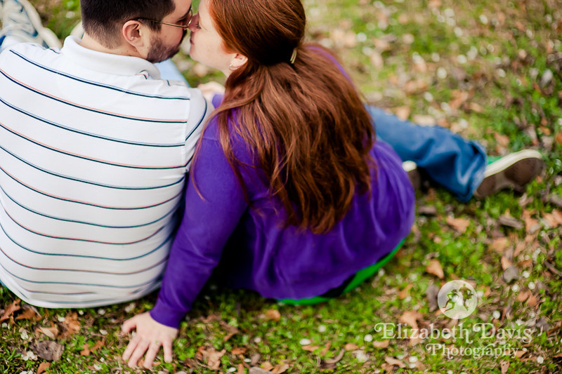 colorful engagement session | green grass and purple cardigan