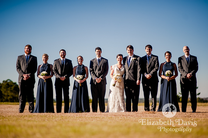 bride and groom with wedding party in dark blue gowns, black suits and blue ties | Southern outdoor wedding | Elizabeth Davis Photography