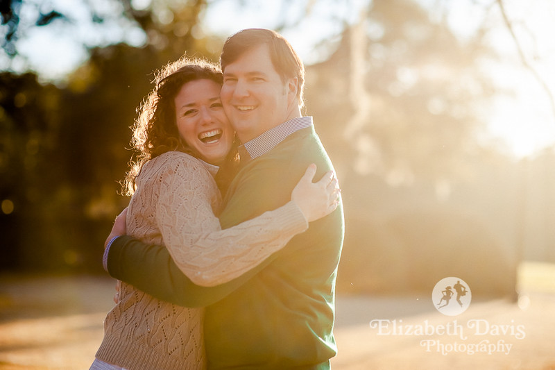 pebble hill engagement photos | bride and groom laugh and hug in the sunshine