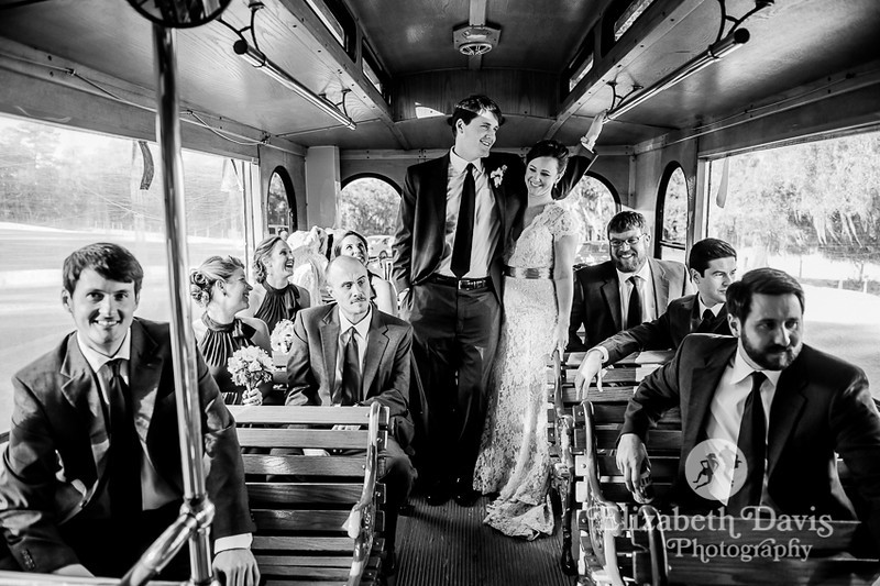 bride and groom with wedding party on trolley | Southern outdoor wedding | Elizabeth Davis Photography