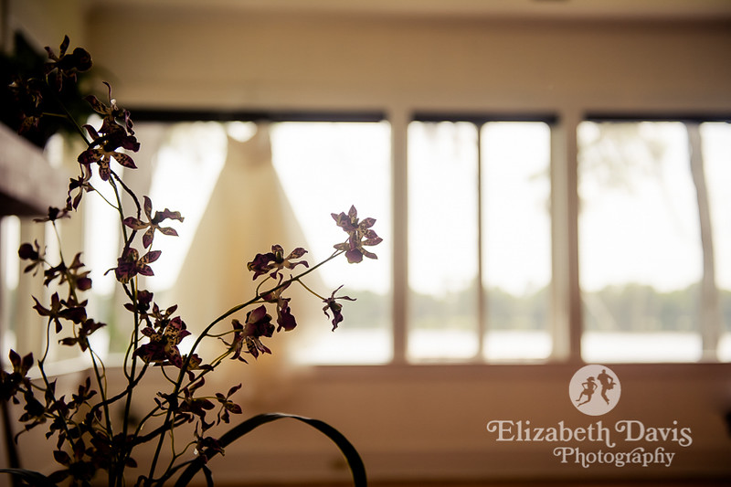 dress hanging with flowers at Pansy Po Cottage at Honey Lake Plantation wedding | Elizabeth Davis Photography