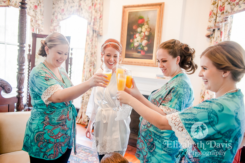 bridesmaids getting ready toasts with custom robes   Southwood House wedding   Elizabeth Davis Photography